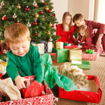 young boy opens gift early Christmas morning